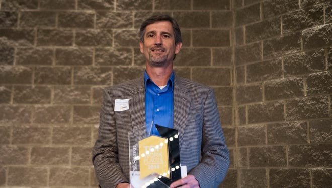 Cannon & Cannon, Inc. receives their award for top small company workplace at the News Sentinel's 2018 Top Work Places awards ceremony at the Foundry in World's Fair Park Tuesday, June 19, 2018.