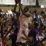 Andrew Wiggins shoots for Huntington Prep during a City of Palms game on Dec. 20, 2012, at Bishop Verot. Wiggins was the No. 1 overall pick in the draft.