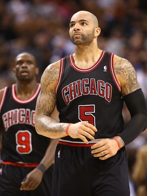 Bulls forwards Carlos Boozer, front, and Luol Deng are in limbo because of large contracts.