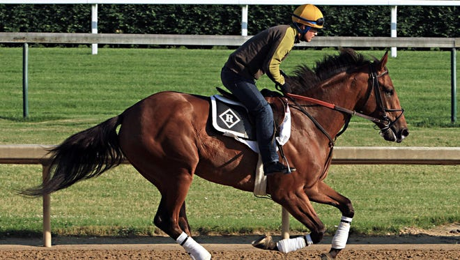 Belmont Stakes hopeful Keen Ice, ridden by exercise rider Faustino Aguilar, gallops at Churchill Downs last week before making the trip to New York.
