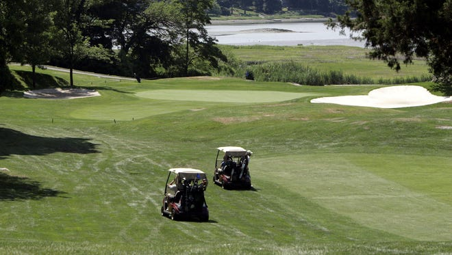 Golfers play the 16th hole at the Rye Golf Club in this file photo.