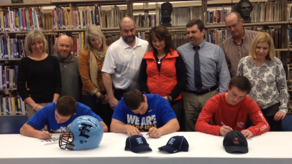 Enka senior Andrew Crowell, far right, signed with the Liberty track program in February.