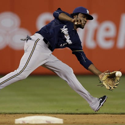 Milwaukee Brewers shortstop Hector Gomez chases down a single by Philadelphia Phillies' Ben Revere.
