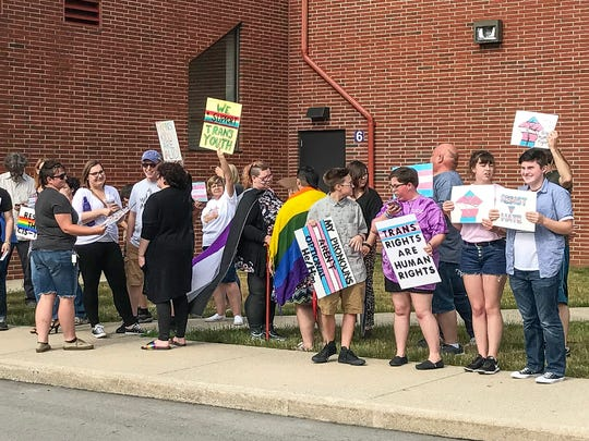 Supporters of transgender students attend a school board meeting at Brownsburg Community School's Central Office on June 11, 2018.