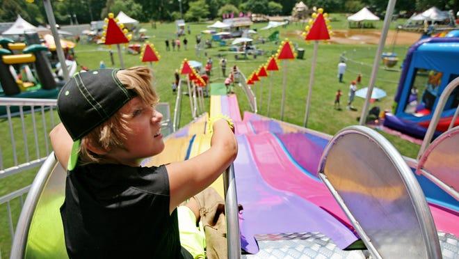 Gavin Webb of Waynesboro takes another trip down the slide at last year's Waynesboro Summer Extravaganza on July 11, 2015 at Ridgeview Park.