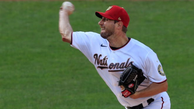 Washington Nationals starting pitcher Max Scherzer (31) throws during the first inning of a baseball game against the New York Mets in Washington, Wednesday, Aug. 5, 2020.