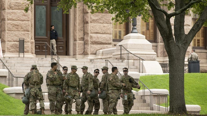 Texas Army National Guard soldiers guard the Capitol on Tuesday June 2, 2020, after three days of protests  Dozens of guardsmen could be seen on the grounds of the Capitol. The National Guard adjutant general said Monday that there are no plans to dispatch troops to polling locations on Election Day.