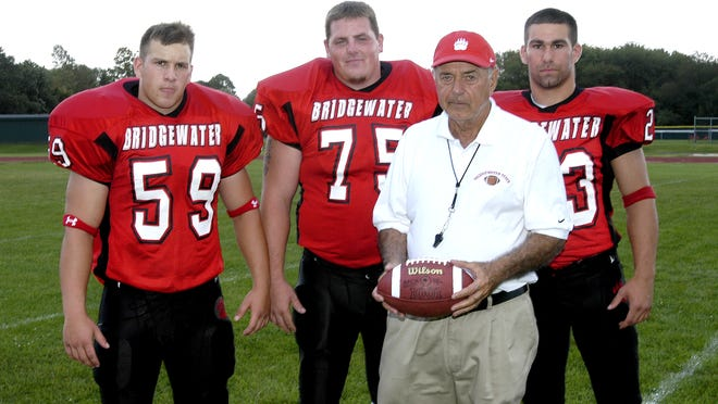 Longtime Bridgewater State football coach Peter Mazzaferro with the captains of the 2004 football team. From left, Sal Longo, Keith Derba and Adam Howe.
