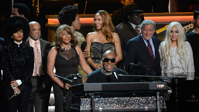 "Stevie Wonder (center) is joined by Janelle Monae (from left), Berry Gordy Jr., Mary Wilson, India Arie, Aisha Morris, Tony Bennett and Lady Gaga at the taping of ""Stevie Wonder: Songs In The Key Of Life — An All-Star GRAMMY Salute"" in Los Angeles."