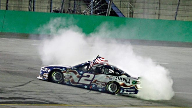 Brad Keselowski does a burnout after winning the NASCAR Sprint Cup race Saturday at Kentucky Speedway in Sparta, Ky.