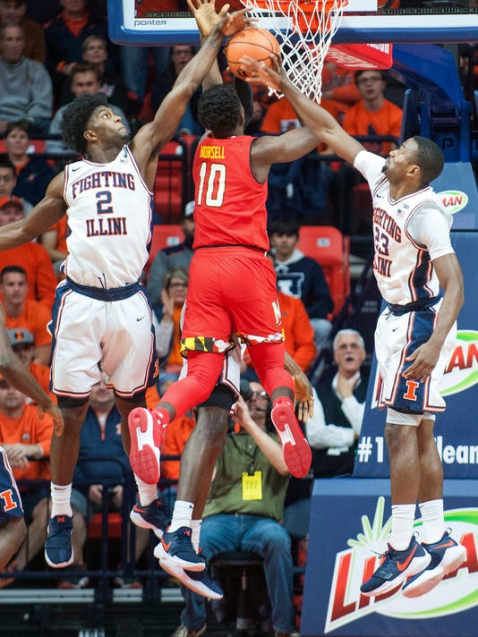 Illinois forward Kipper Nichols (2) and guard Aaron Jordan (23) attempt to block a shot by Maryland guard Anthony Cowan (1) during an NCAA college basketball game in Champaign, Ill., Sunday, Dec. 3, 2017. (AP Photo/Robin Scholz)