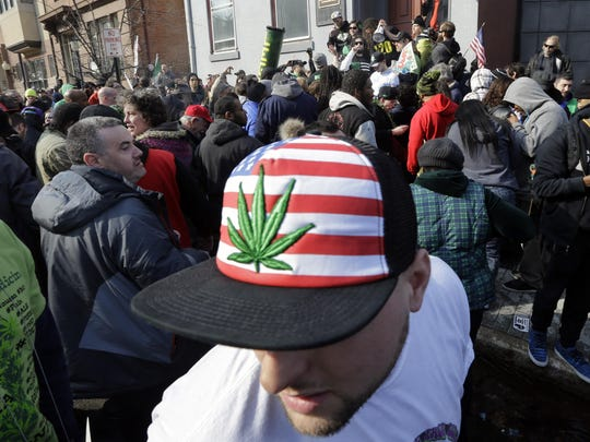 A man wears a hat with a marijuana depiction as a large group gathered near the New Jersey Statehouse to show their support for legalizing marijuana on March 21, 2015, in Trenton. The event was led by Ed Forchion, a pro-marijuana activist known as NJ Weedman.