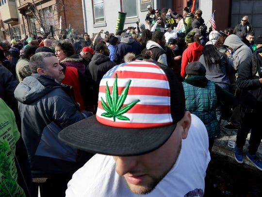 A man wears a hat with a marijuana depiction as a large group gathered near the New Jersey Statehouse to show their support for legalizing marijuana Saturday, March 21, 2015, in Trenton, N.J. The event was led by Ed Forchion, a pro-marijuana activist known as NJ Weedman. He renewed his calls for lawmakers to legalize the drug, saying it should be treated like alcohol. (AP Photo/Mel Evans)
