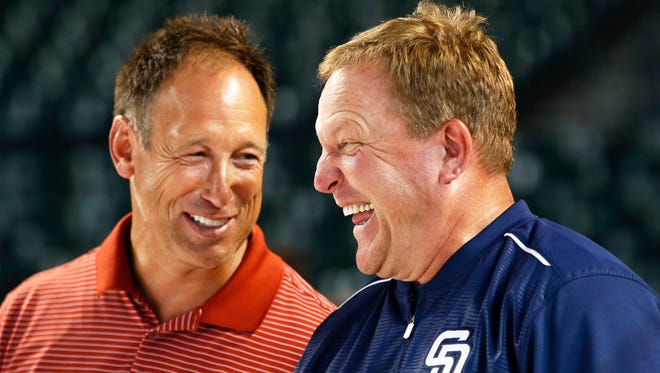 San Diego manager Pat Murphy (right) laughs with his old friend and former Diamondback Luis Gonzalez during batting practice at Chase Field on Friday, June 19, 2015 in Phoenix.