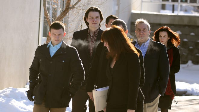Leaving the Monroe County Jail, Colin Rideout (L-R facing) his brother Alexander, Paul Tucci and Laura Rideout after being arraigned for the murder of Craig Rideout. Craig Rideout is the ex-husband of Laura and the father of the boys.  Tucci is the boyfriend of Laura.