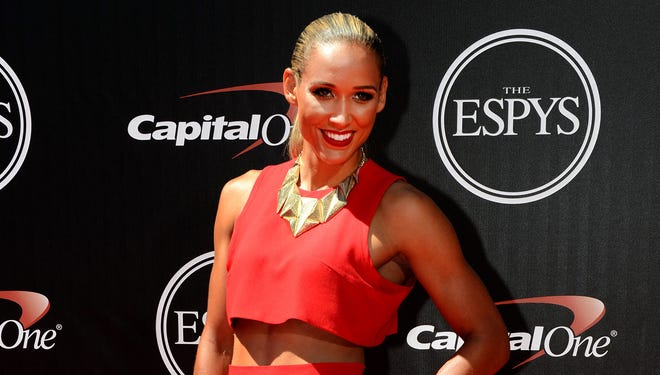 Jul 16, 2014; Los Angeles;  American track and field and bobsler Lolo Jones arrives at the 2014 ESPY Award show at Nokia Theatre.