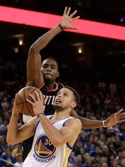 Golden State Warriors' Stephen Curry (30) looks to shoot ahead of Portland Trail Blazers' Maurice Harkless during the second half of an NBA basketball game Friday, March 11, 2016, in Oakland, Calif.
