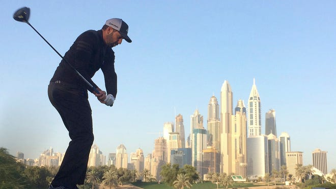Sergio Garcia tees off on the eighth hole during the second round of the Dubai Desert Classic.