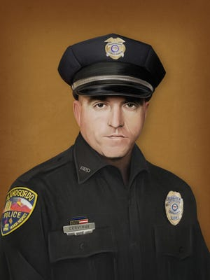 Jonny Castro, a police officer and forensic composite artist, painted this portrait in memory of fallen police officer Clint Corvinus.