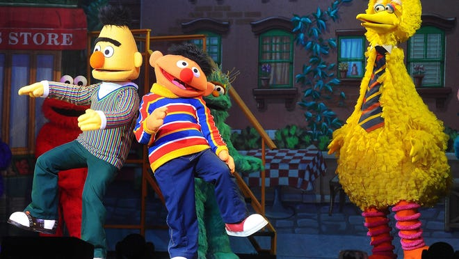 """Bert and Ernie dance as Big BIrd looks on during the live performance of Sesame Street Live """"Let's Dance!"""" at the Denny Sanford PREMIER Center on Jan. 13. The Sesame Street Live production """"Let's Dance!"""" originally set for October at Bon Secours Wellness Arena, has been rescheduled for June 2016."""