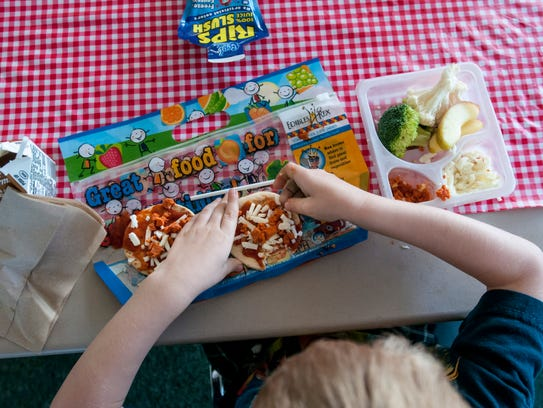 Kids make small pizzas during Meet Up and Eat Up Wednesday,