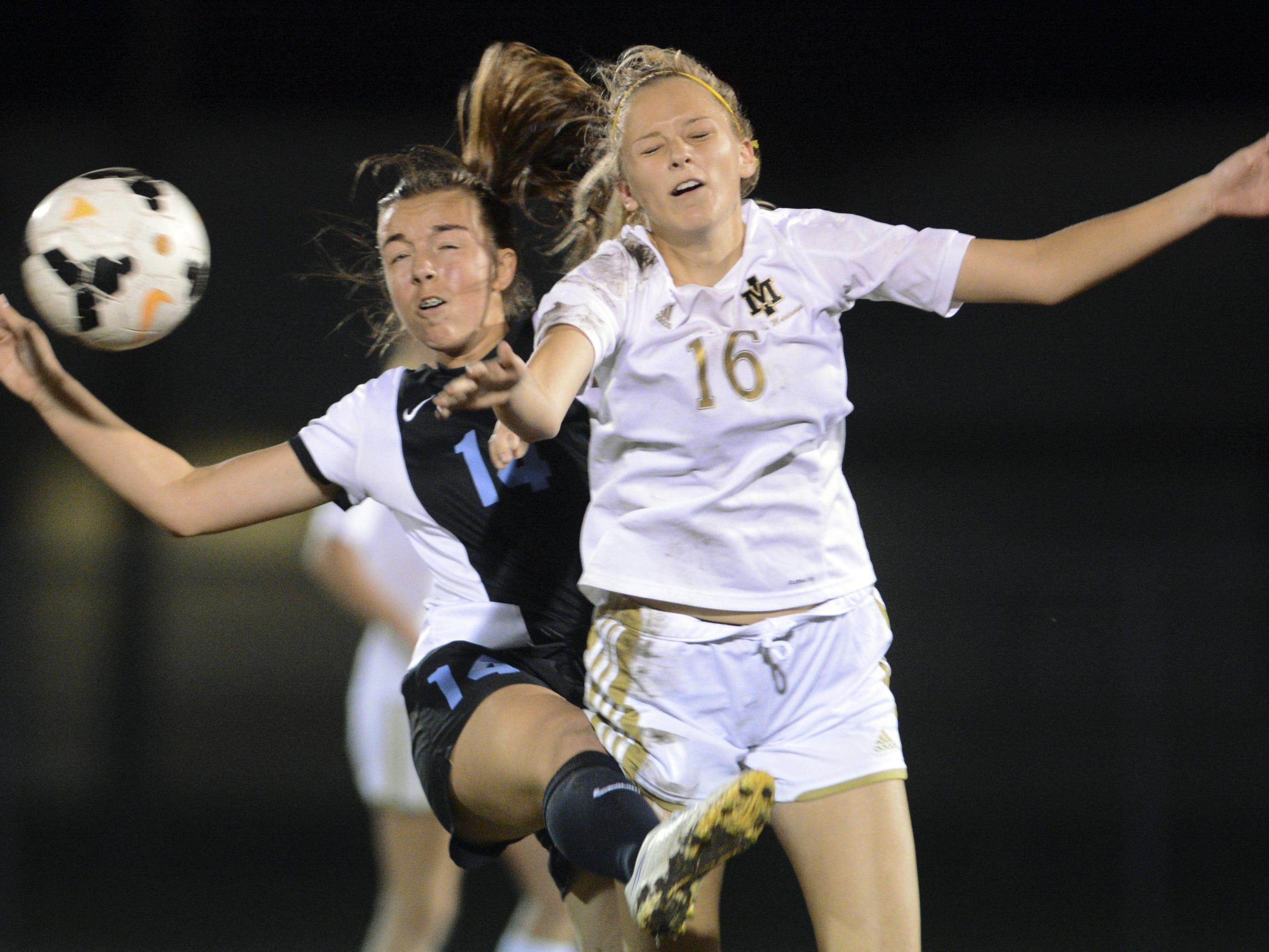 Haley Wardwell of Rockledge and Madeline Miller of Merritt Island collide as they go for a ball during Friday's game.