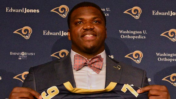 Greg Robinson is introduced by St. Louis Rams head coach Jeff Fisher and general manager Les Snead after being taken in the first round of the 2014 NFL Draft.