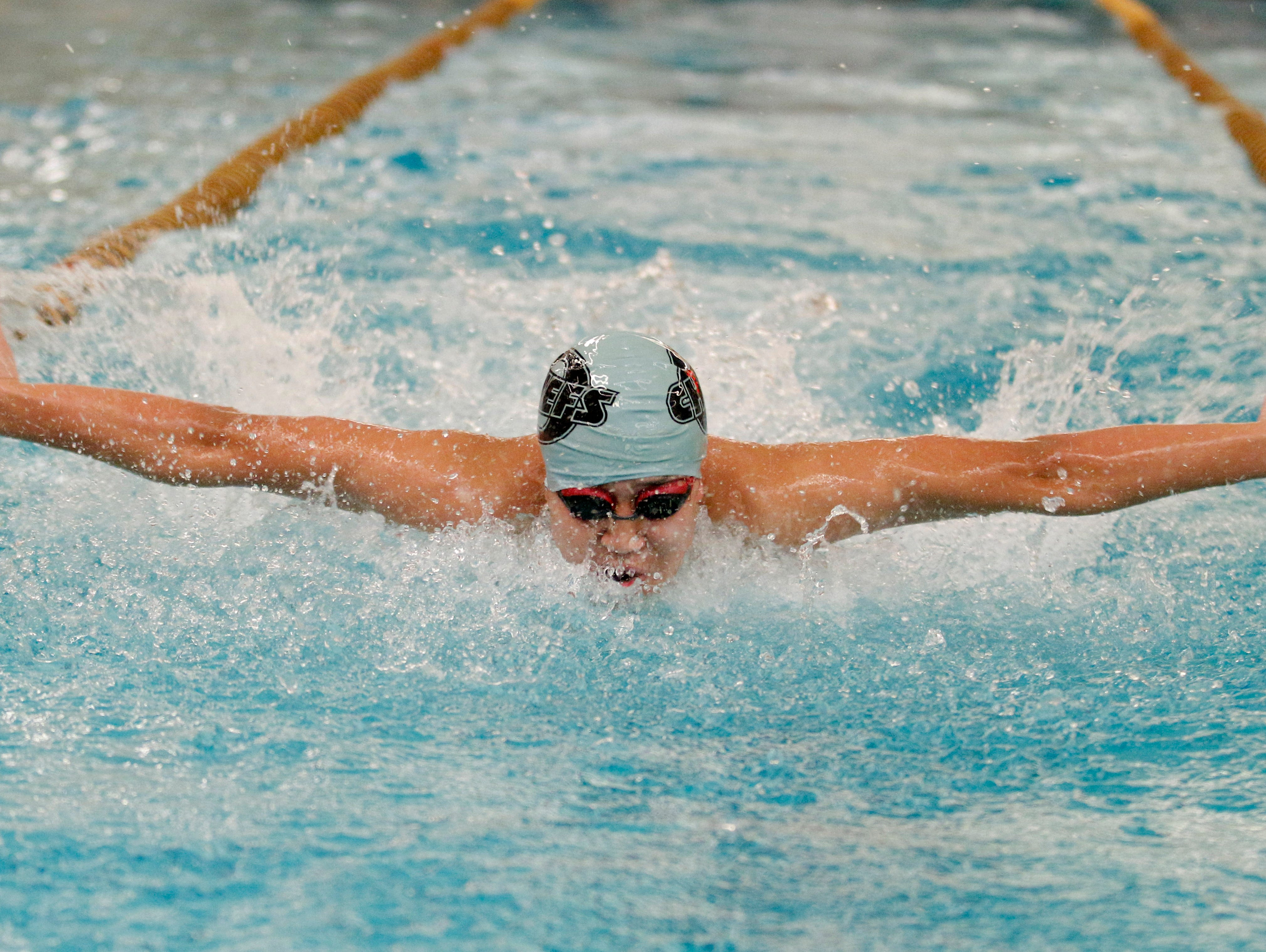 An Okemos swimmer competes in the 200 yard Butterfly in the Waverly Relays Wednesday, Dec. 7, 2016, at Waverly High School.