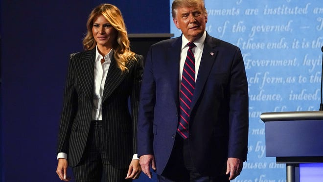 President Donald Trump stands on stage with first lady Melania Trump after the first presidential debate with Democratic presidential candidate former Vice President Joe Biden Tuesday, Sept. 29, 2020, at Case Western University and Cleveland Clinic, in Cleveland, Ohio.