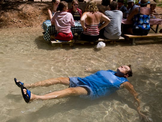 Camper Deb Fedderke, of Delta, Ohio, cools off as family