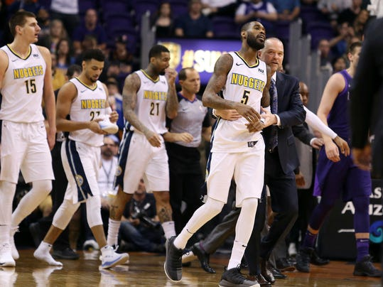 Denver Nuggets guard Will Barton (5) is escorted to the bench by coach Michael Malone, right, after being called for a technical foul during the first half of an NBA basketball game against the Phoenix Suns, Saturday, Feb. 10, 2018, in Phoenix. (AP Photo/Ralph Freso)