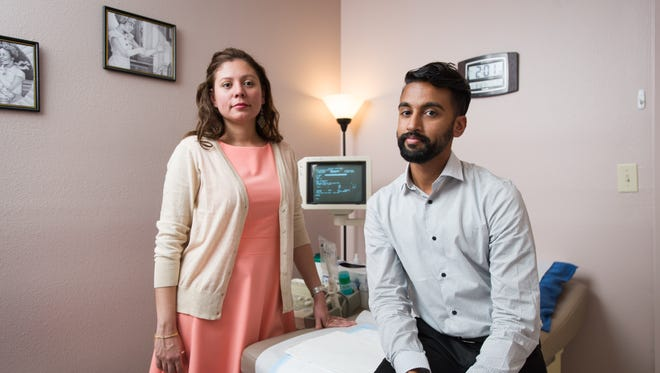 Andrea Ferrigno, corporate vice president of Whole Woman's Health, and Bhavik Kumar, M.D., pose for a photograph in one of the San Antonio clinic's exam rooms.