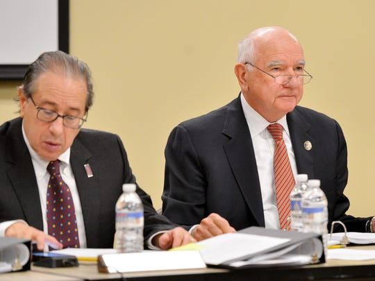 From left: Commissioner Jeffrey H. Lynford and Chairman John Degnan fail to reach consensus at a Port Authority board meeting December 8, 2016.