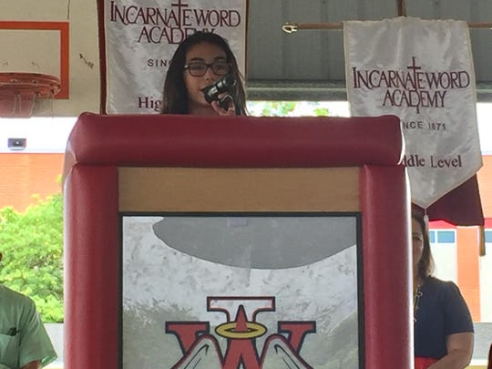 Allie Salazar, Incarnate Word Academy's elementary level student council president, gives a speech at the groundbreaking ceremony.