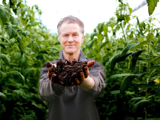 East Thetford farmer David Chapman displays two handfuls