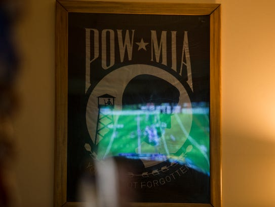 The Minnesota Vikings game is reflected in a POW/MIA