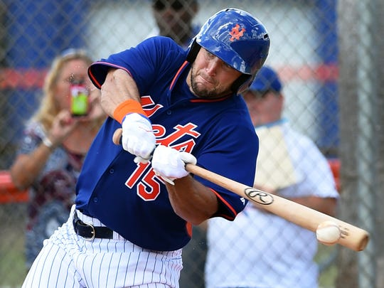 Tim Tebow connects with the ball Wednesday, Sept. 28, 2016, during his first Florida Instructional League game with the St. Lucie Mets against prospects of the St. Lucie Cardinals on the backfields of the Tradition Field complex in Port St. Lucie.