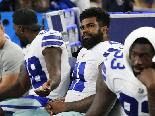 Dallas Cowboys  running back Ezekiel Elliott (21) on the bench during the game against the Oakland Raiders at AT&T Stadium.