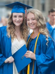 Jenna Guy and Alexis Felice pose for a photo minutes before the 2017 Millville High School Graduation.