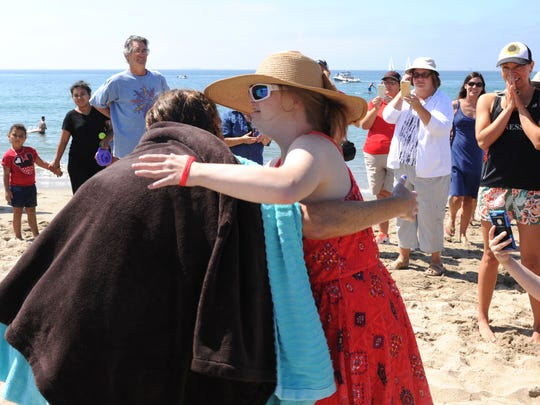 Rachel Horn gets a hug from Special Olympics athlete Althea Barilone-Hayes after Saturday's swim.