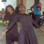 Frances Barker, left, and Jazzmin Evans of PJ's Dance and Art Studio perform an interpretive dance during last year's Juneteenth Folklife Celebration. The 33nd annual African American cultural celebration, sponsored by Creole Heritage, Inc., is scheduled for Saturday at the Opelousas Farmers Market.