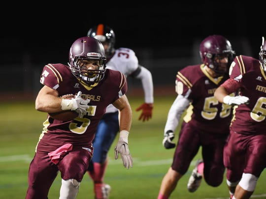 Arlington High School's Rob Tannenbaum rushes against Roy C. Ketcham during a 2015 football game.