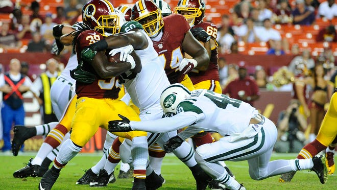 Aug 19, 2016; Landover, MD, USA; Washington Redskins running back Keith Marshall (39) is tackled by New York Jets nose tackle Tarow Barney (60) during the second half at FedEx Field. Mandatory Credit: Brad Mills-USA TODAY Sports