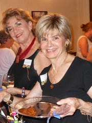 Ludy Sanderson, left, and Barbra DeMichels at the International Dinner Festival hosted by the Newcomers Club of Montgomery (Contributed)