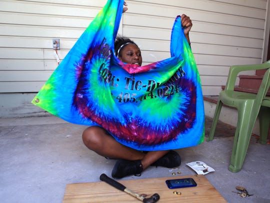 Micah Cain, 17, owner of Tie Dye Chick, works on a