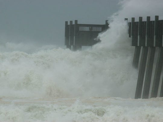 The Pensacola Beach Pier is pummeled by waves caused by Hurricane Ivan on Wednesday.