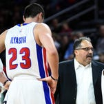 Detroit Pistons coach Stan Van Gundy, center, talks with forward Ersan Ilyasova, left, and guard Reggie Bullock, right, against the Charlotte Hornets at the Palace of Auburn Hills.