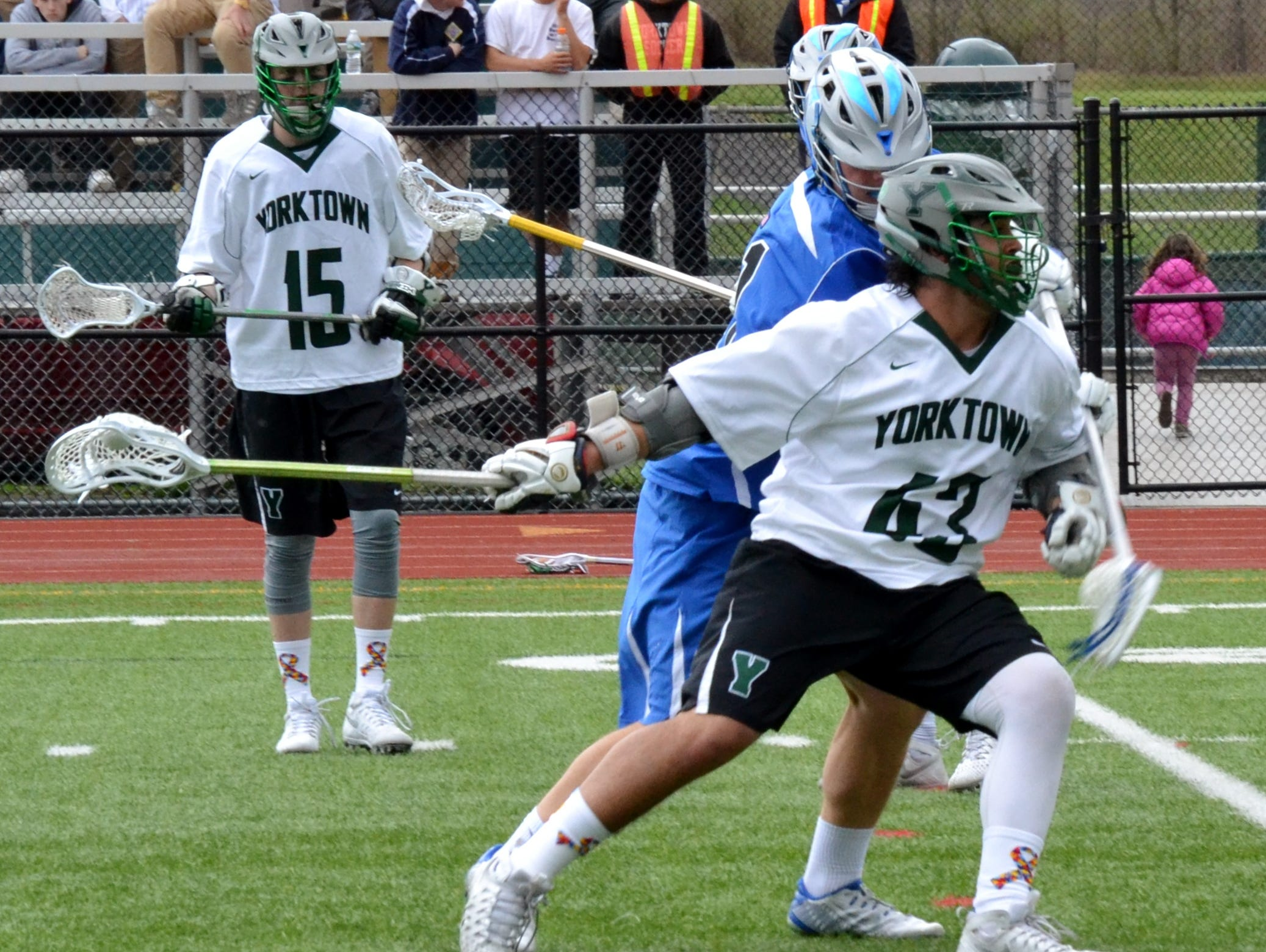 Yorktown attackman Justin Cavallo struggles to get loose on Saturday during a 12-3 loss to Darien, Conn.