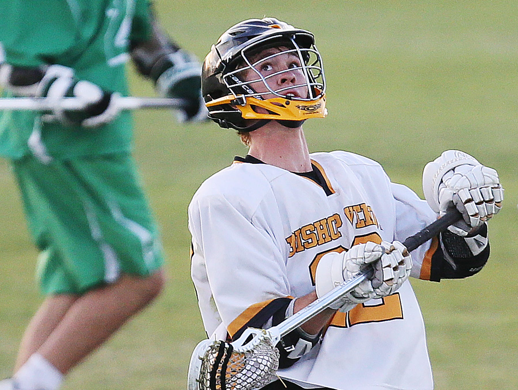 Bishop Verot High School's Luke Lanman gathers a pass against Fort Myers during the District 18 lacrosse final Friday at the Canterbury School in Fort Myers. Bishop Verot beat Fort Myers 13-6.