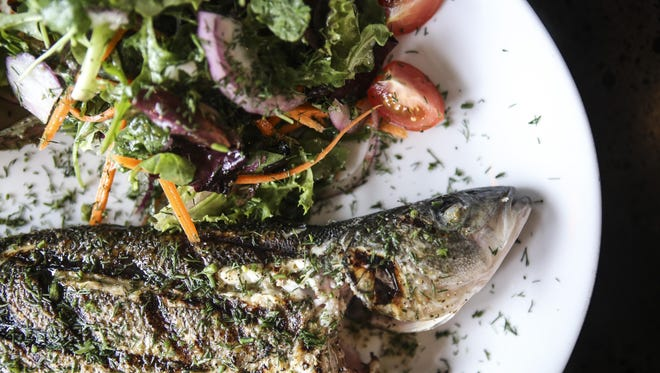 Cafe Mediterranean's Branzino Fish, a Mediterranean sea bass with sprinkled dill, garlic and bay leaves.